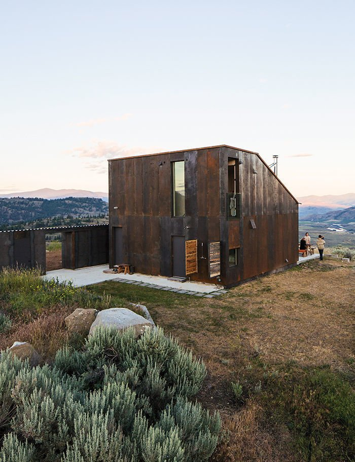 Architect Jesse Garlick's rural Washington vacation home references its rugged surroundings. The steel cladding has developed a patina similar to the ochre-red color of bedrock found in the area.  Tagged: Exterior, Metal Siding Material, and Metal Roof Material.  Sky House by Dwell