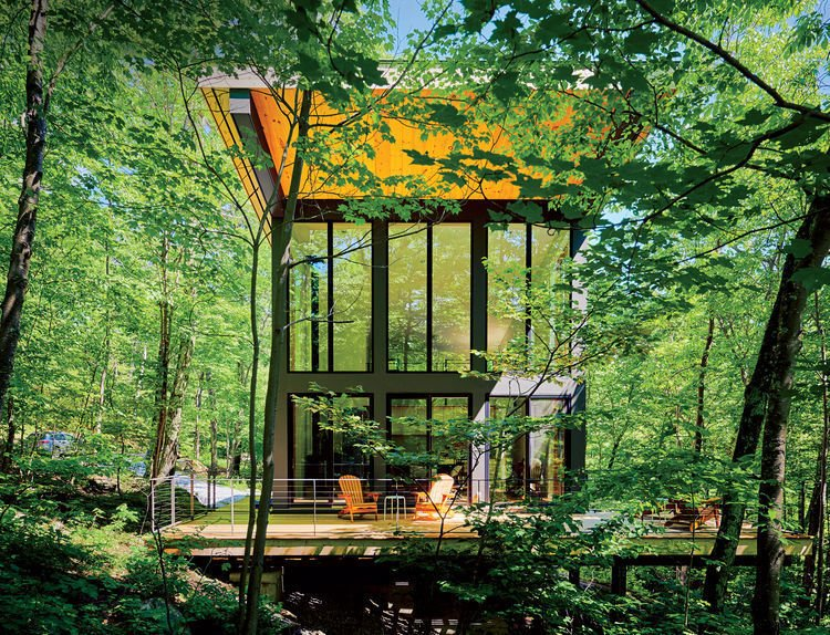 A cantilevered cabin designed by R D Gentzler blends into the forest, even as it hovers above a 20-foot drop-off. Its south face is almost entirely glass, but a roof canopy limits solar gain.  Tagged: Exterior, Cabin Building Type, and Shed RoofLine.  Cabins & Hideouts by Stephen Blake from Gentzler's Cantilevered Cabin