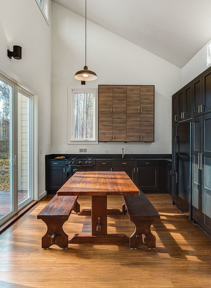 To keep costs down elsewhere (the house was built for just over $118,000), architect Brun and his partner Lizmarie Esparza specified Ikea kitchen cabinets and a black refrigerator, which is less expensive than stainless steel.