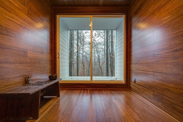 The room is clad entirely in bamboo and frames a view of the surrounding deciduous forest.  Photo 3 of Gordon Cabin modern home