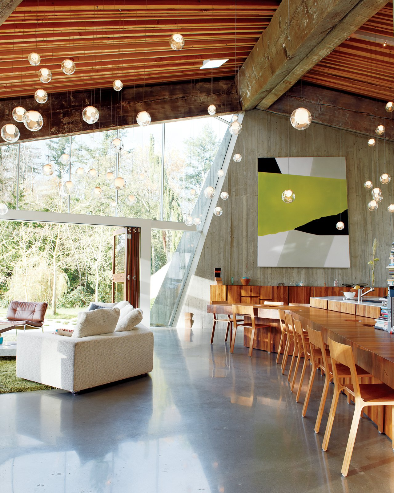 #interior #greatroom #livingroom #diningroom #couch #chair #lighting #concrete  60+ Modern Lighting Solutions by Dwell