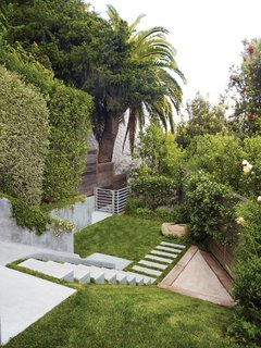 25 Blissful Backyards - Photo 21 of 25 - Concrete meets greenery in the backyard.