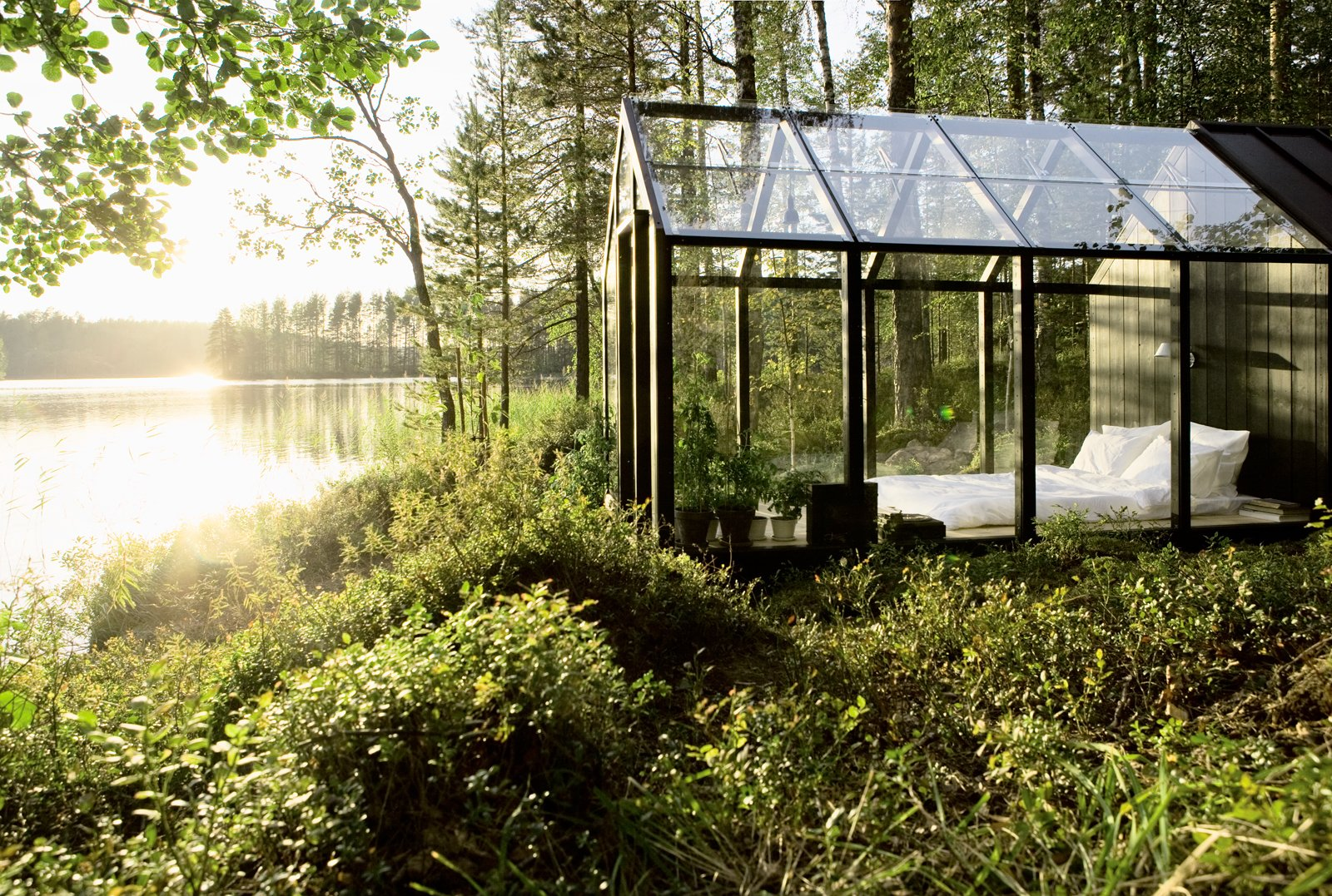 #prefab #Finland #glass #shed #bed #light #green #escape #outdoor  Off the grid by Michela O'Connor Abrams from Cabin