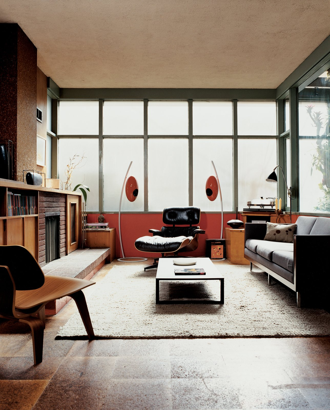 #midcenturymodern #Eames #HermanMiller #lounge #chair #livingrooms #U-vola #speakers #EliteAudioSystems #GretchenRice #KevinFarnham Tagged: Living Room, Rug Floor, Coffee Tables, Standard Layout Fireplace, Sofa, Recliner, Lamps, Ottomans, Chair, End Tables, and Floor Lighting.  Photo 32 of 54 in Eames Lounge Chair Porn