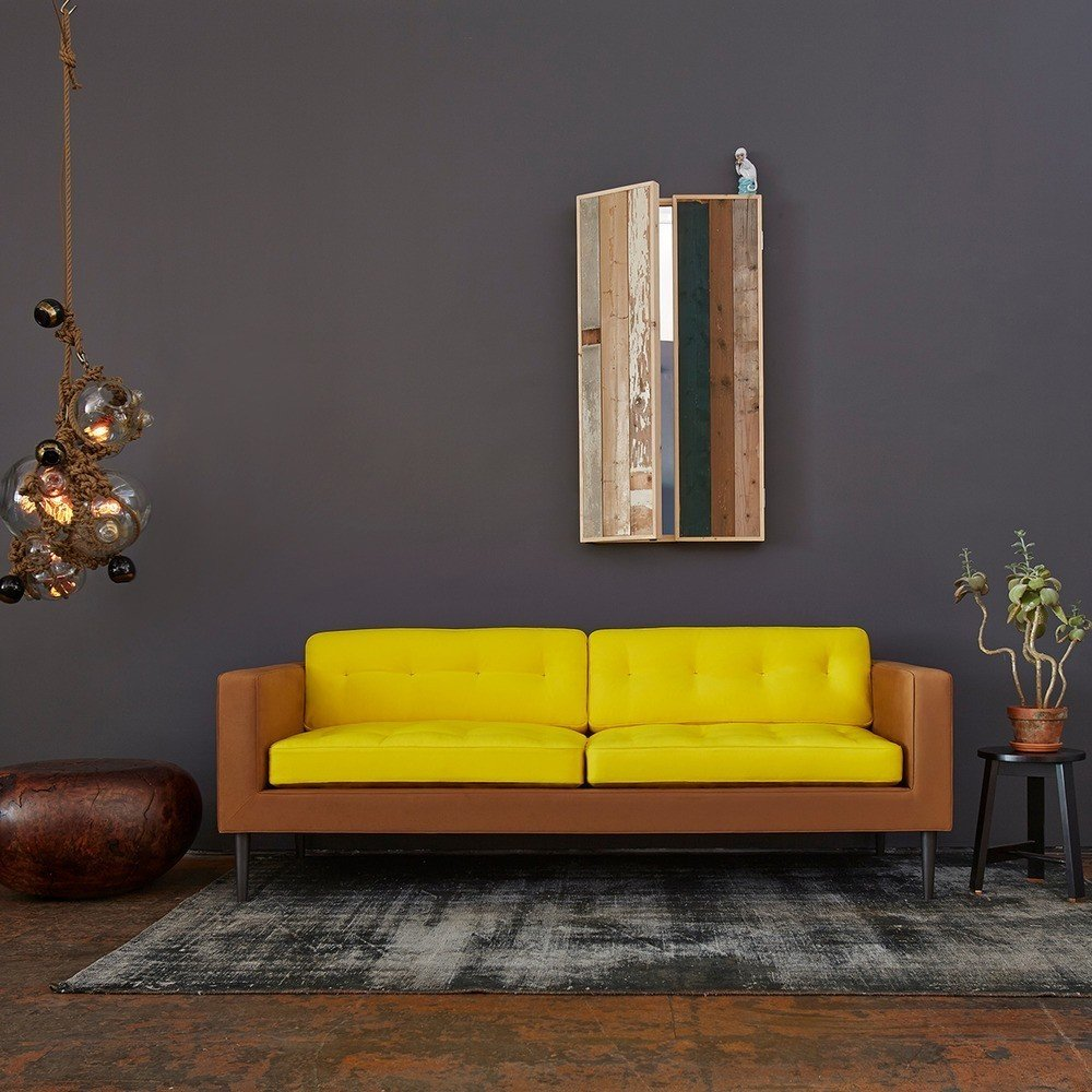 #interior #design #interiordesign #yellow #camel #sofa #yellowsofa #gray #graywall #wood #lighting #ropelights #ropelighting #succulence #1970s #lindseyadelman #tardi #tardisofa #color #colorful #decor #homedecor  36+ Interior Color Pop Ideas For Modern Homes by Dwell