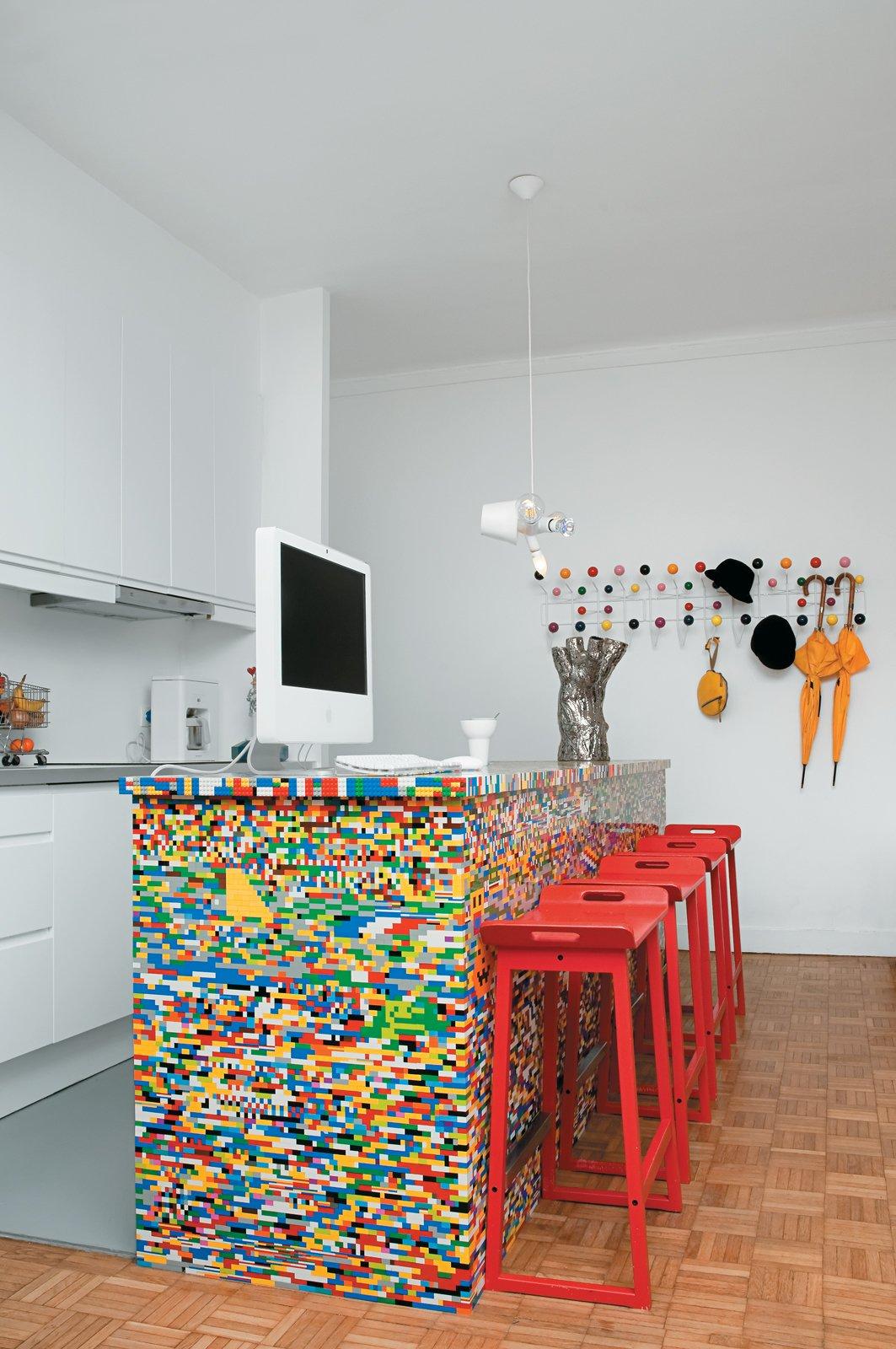 #interior #design #interiordesign #modern #kitchen #legos #color #colorful #redchairs #countertop #counter #stool #desk #coathanger #paris #philipperossetti #simonpillard #munchausen #kitchenisland   36+ Interior Color Pop Ideas For Modern Homes by Dwell