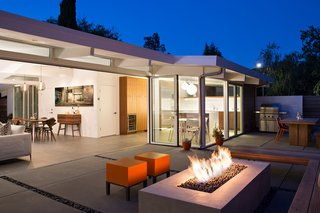 25 Blissful Backyards - Photo 14 of 25 - An indoor-outdoor space with a modern fire pit.