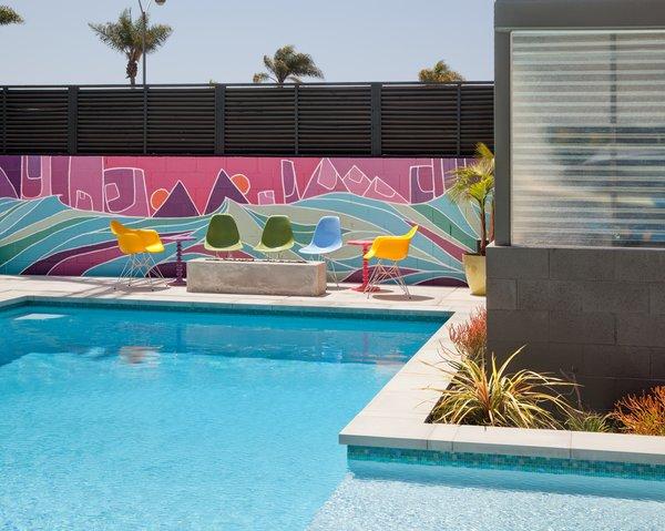 #outdoor #design #modern #outside #indooroutdoorliving #exterior #backyard #pool #art #mural #nateschnell #color #eameschair #eames #sandiego   Photo by Jim Brady