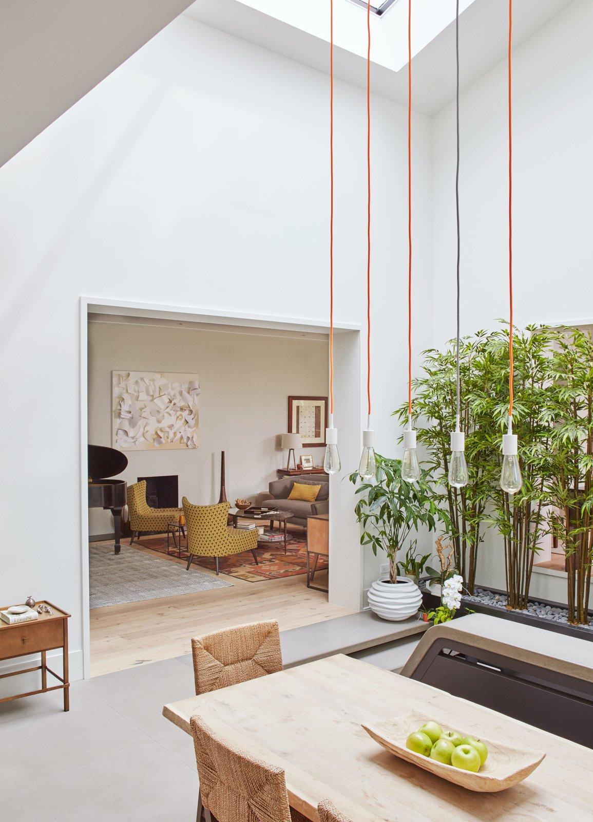 #soco #pendantlights #techlighting #lighting #interior #modern #cordlights #diningroom #livingroom #naturallighting #woodtable    60+ Modern Lighting Solutions by Dwell