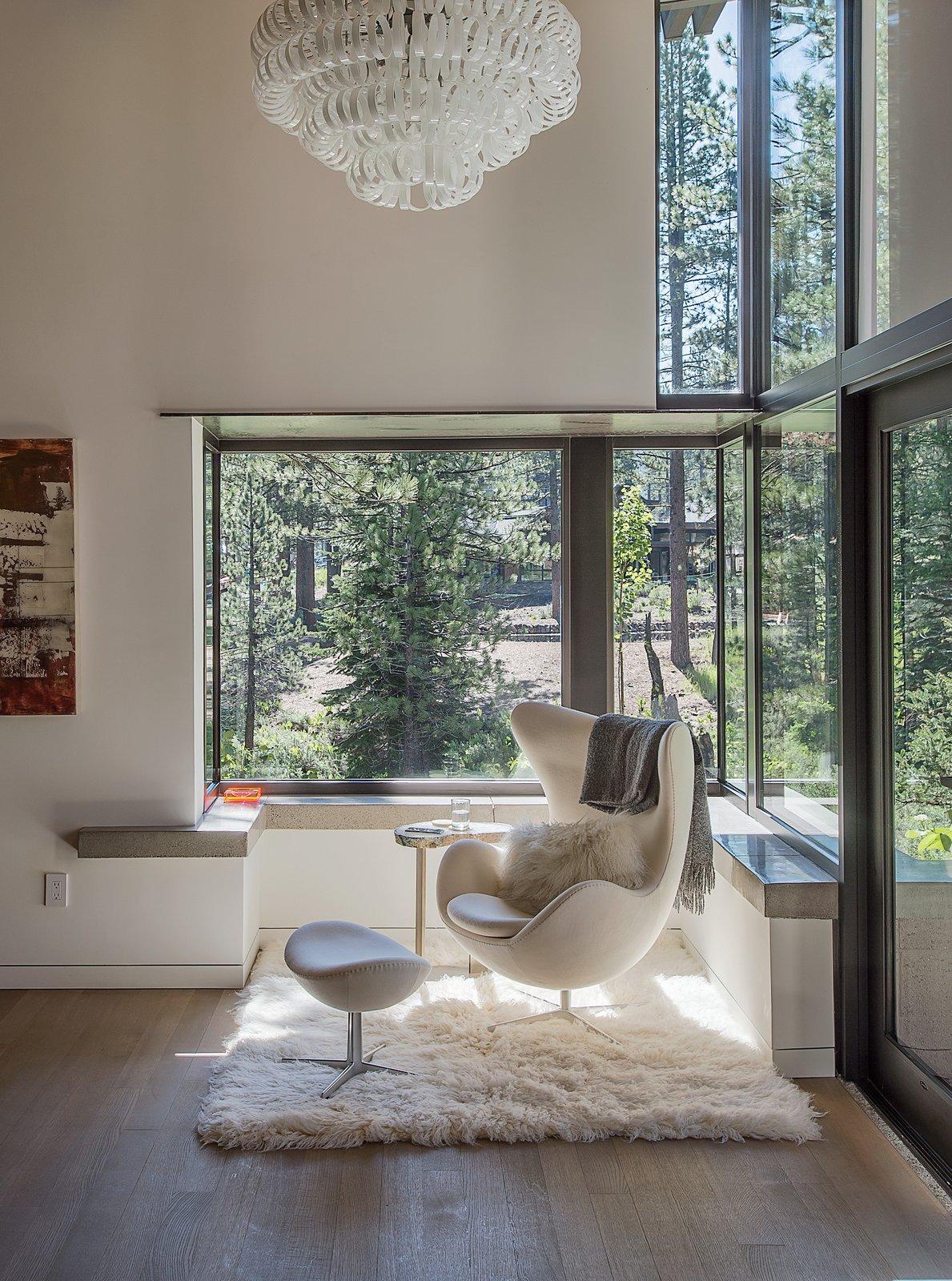 #interior #modern #inside #design #interiordesign #eggchair #flokati #flokatirug #rug #windows #chandelier #forest #concrete #wallart #sidetable #naturallighting #seatingdesign #seating  100+ Best Modern Seating Designs by Dwell