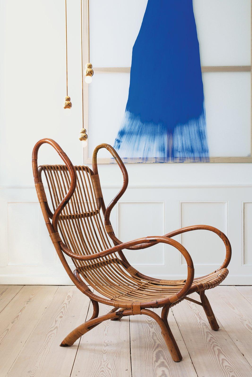 #interior #modern #inside #design #interiordesign #gioponti #chair #1963 #daniellergon #painting #balllights #michaelanastassiades #allwhitepaint #farrowandball #wickerchair #wicker #lighting #art #seatingdesign #seating  Photo courtesy of the Apartment 100+ Best Modern Seating Designs by Dwell