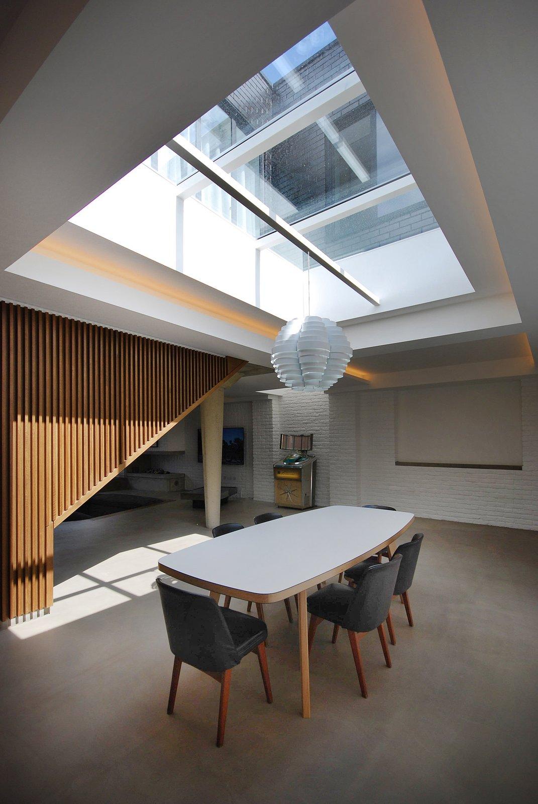 #interior #dining #modern #table #diningarea #naturallighting #skylight #london #jamesburleigh #brick #industrial #woodwall