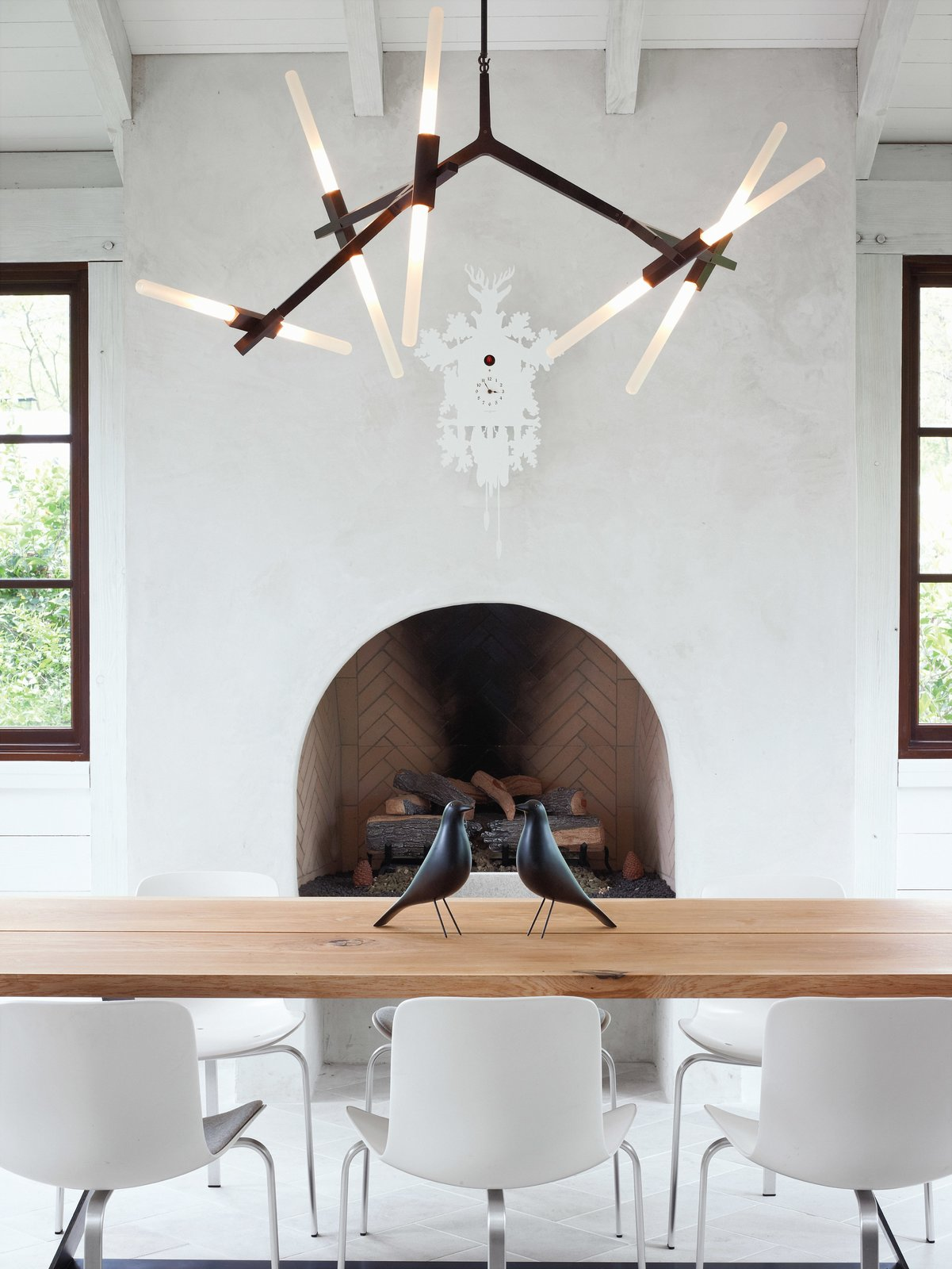 #interior #fireplace #modern #diningroom #chandelier #woodfireplace #rustic #bronze #lindseyadams #roll&hill #terrydwan #folkart #eames #eameshousebirdds #cuckooclock #Diamantini&Domeniconi #pk8 #republicoffritzhansen #PoulKjærlholm #kuhl-linscomb #houston #texas