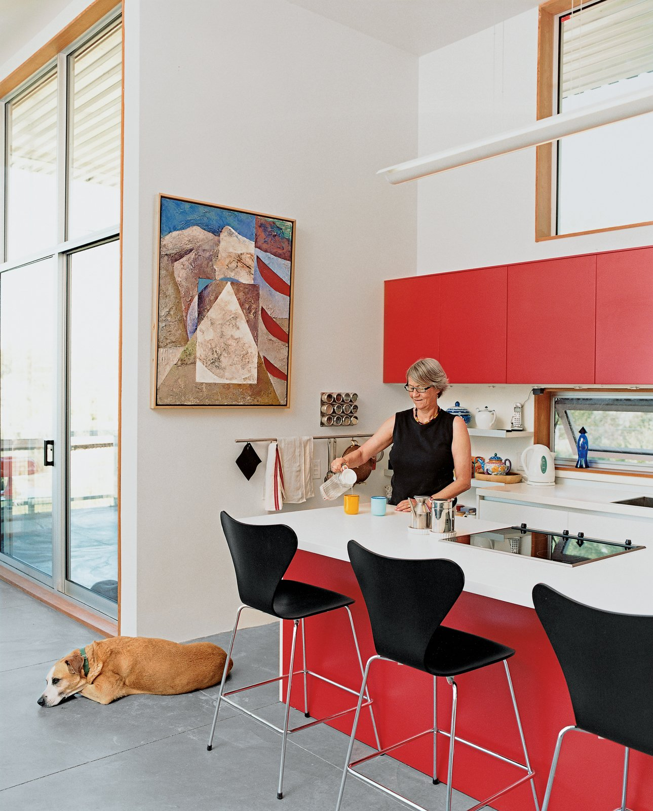 #kitchens #indoor #inside #interior #modern #midcentury #minimal #function #red #cabinets #island #stools #color #dog #Varenna #NewMexico