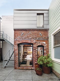 10 Tiny Houses We Love - Photo 8 of 10 - Architect and metalworker Christi Azavedo was tasked with transforming a 93-square-foot brick boiler room from 1916 into a guesthouse in San Francisco. She spent a year-and-a-half designing and fabricating nearly everything in the structure, except for the original brick walls.