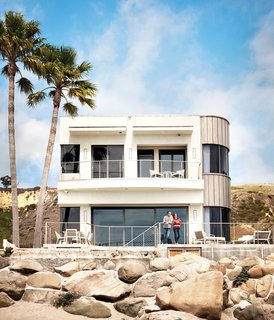 """Actor Bryan Cranston's Green Beach House Renovation - Photo 8 of 27 - For the facade, exposed to the constant salt air, the team considered everything from copper or zinc to Kynar-coated aluminum. Eventually, a sample of titanium was tacked up for six months and showed no wear. """"Part of the green philosophy is not just what is cheaper; it's what's sustainable,"""" Cranston explains. """"The titanium cladding was more expensive, but this is a house we plan to be in for the rest of our lives, so we wanted something that needed virtually no maintenance."""""""