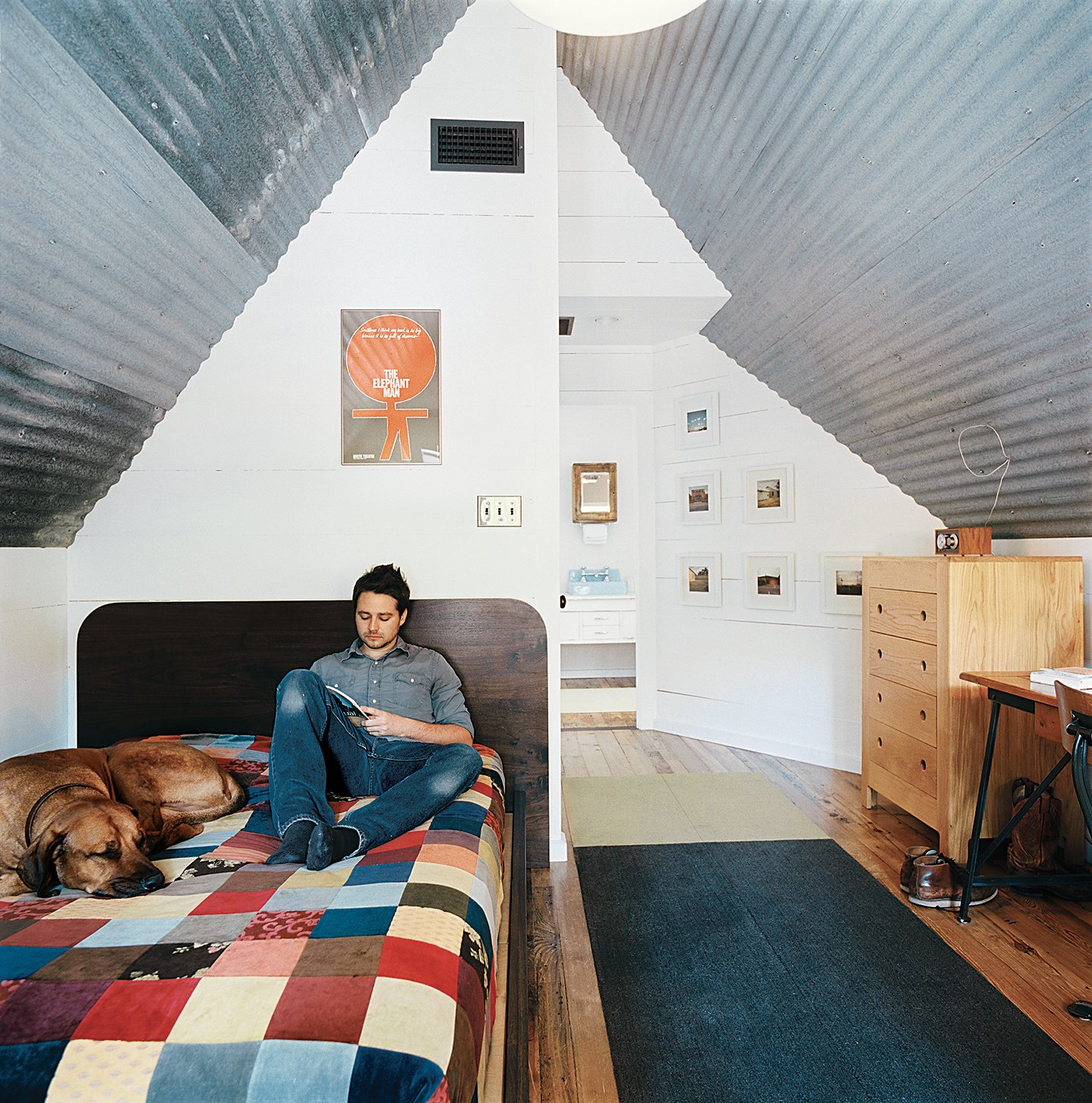 The bedroom takes up the small second floor of the house.  Bedrooms by Dwell from Salvage Love