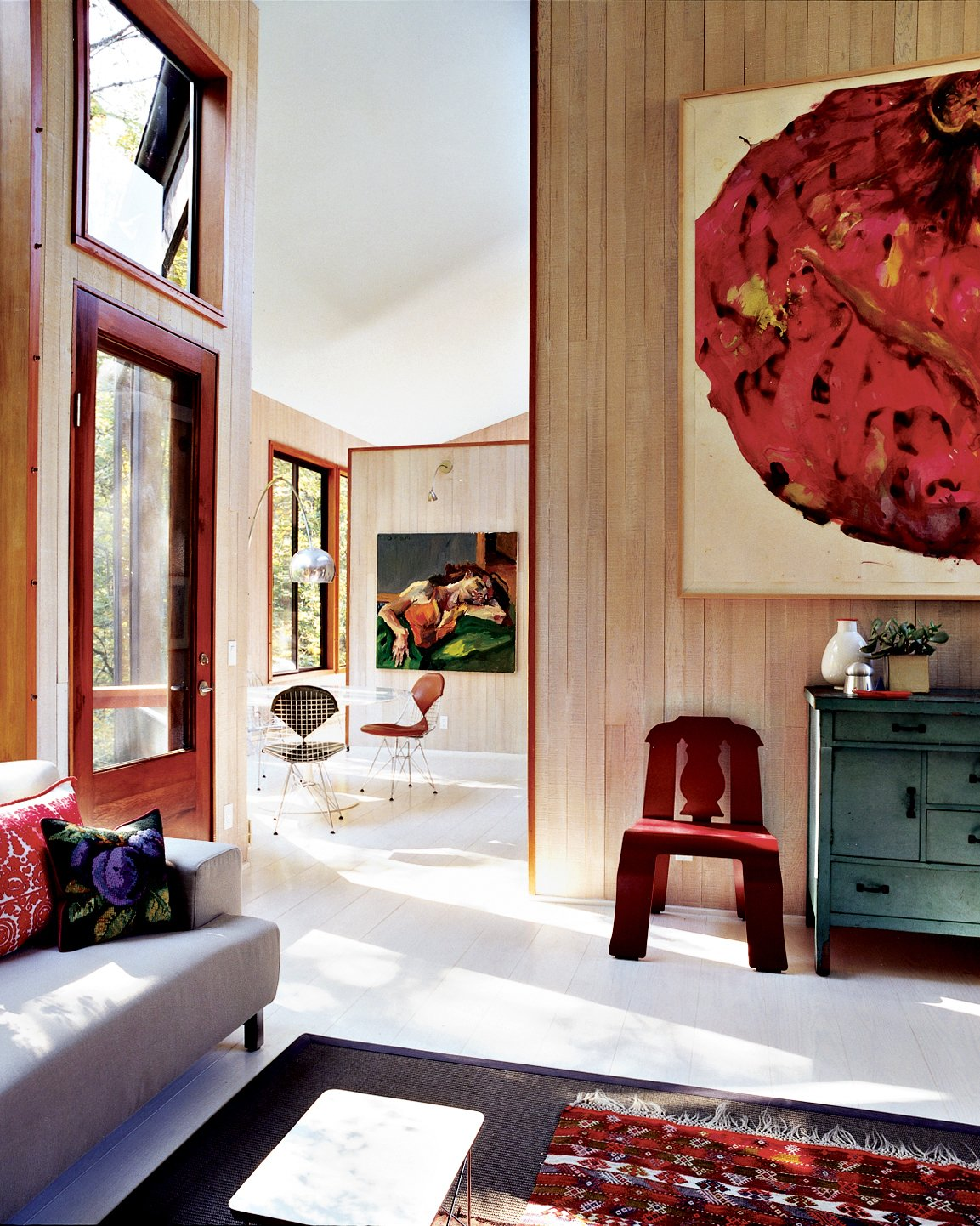 Natural light fills the home, which Watson and Tschopp decorated with a mix of modern classics, thrift-store finds, and more contemporary design pieces like the Cappellini couch. Tagged: Living Room, Sofa, and Chair.  Photo 2 of 6 in The Pace of Portland