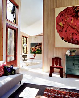 The Pace of Portland - Photo 2 of 6 - Natural light fills the home, which Watson and Tschopp decorated with a mix of modern classics, thrift-store finds, and more contemporary design pieces like the Cappellini couch.