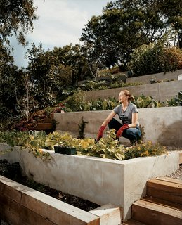 Echo Logical - Photo 11 of 15 - Wakeland goes to work on the garden terraces where the couple grows much of their own food.