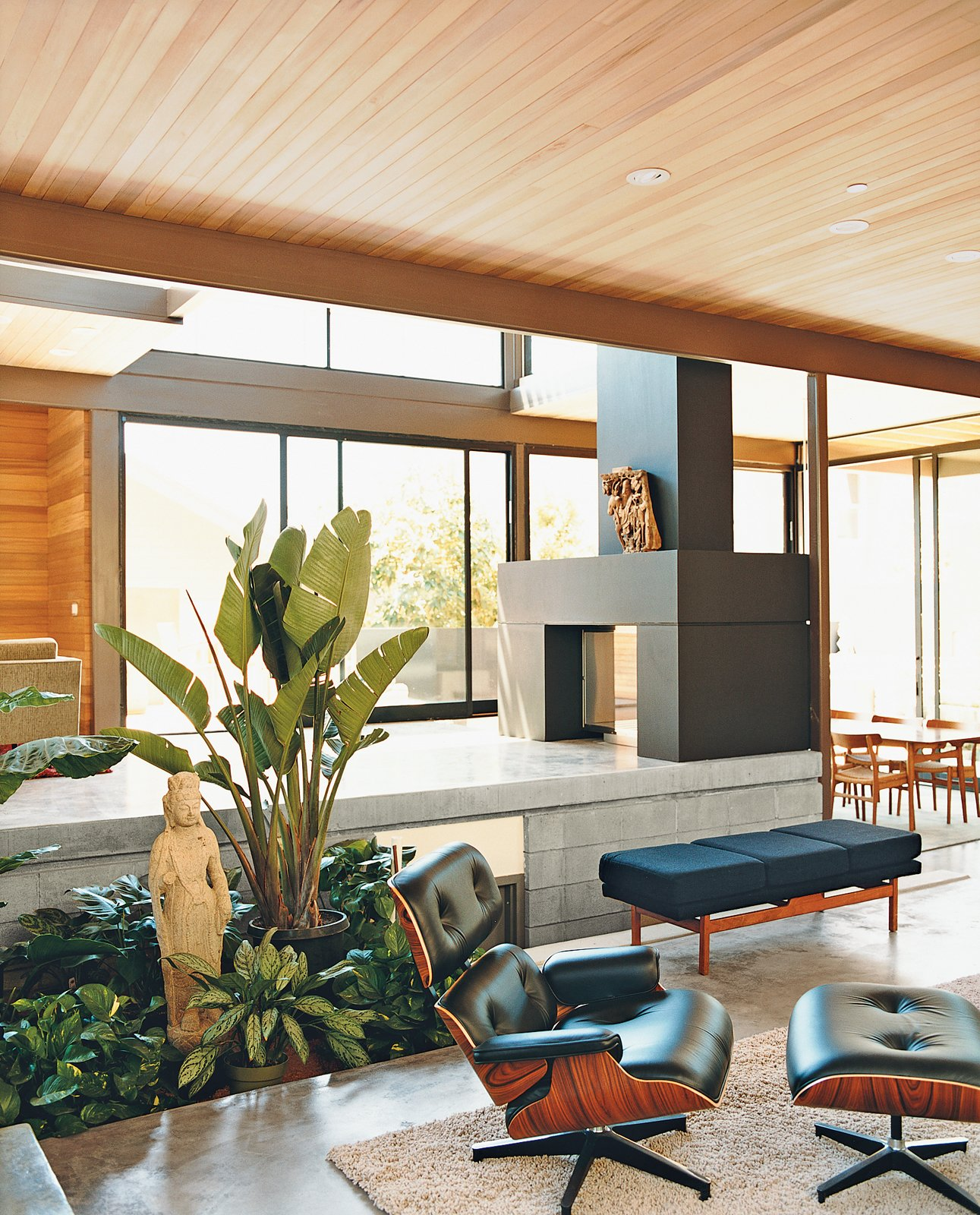 The lower living space on the ground floor of a Los Angeles, California, home features an EcoSmart fireplace fueled by denatured alcohol. Read the full article here. Tagged: Living, Recliner, Concrete, and Two-Sided.  Best Living Concrete Recliner Photos from LEEDing the Way