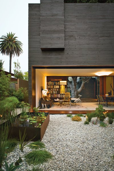 Architectural designer Sebastian Mariscal and project manager Jeff Svitak created a house in Venice, California, for Michael and Tamami Sylvester. The knotty cedar cladding from Crenshaw Lumber was pretreated with an ebony stain from Timber Pro UV—twice on both sides—prior to being brought to the site, where it was left for eight weeks so that it could adjust to the moist seaside air before installation. Photo by Coral von Zumwalt.<br><br>Click here to peep a 360-degree panoramic view of Dwell Home Venice.