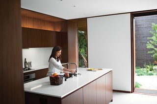 """I love the house more each day,"" says Tamami Sylvester of her and husband Michael's home by Sebastian Mariscal in Venice, California. The kitchen, which includes all Miele appliances, is sheathed in custom woodwork from Semihandmade. Accessories from A+R complement the Caesarstone countertops and Franke faucet. A LifeSource Water System provides filtration. Photo by Coral von Zumwalt."