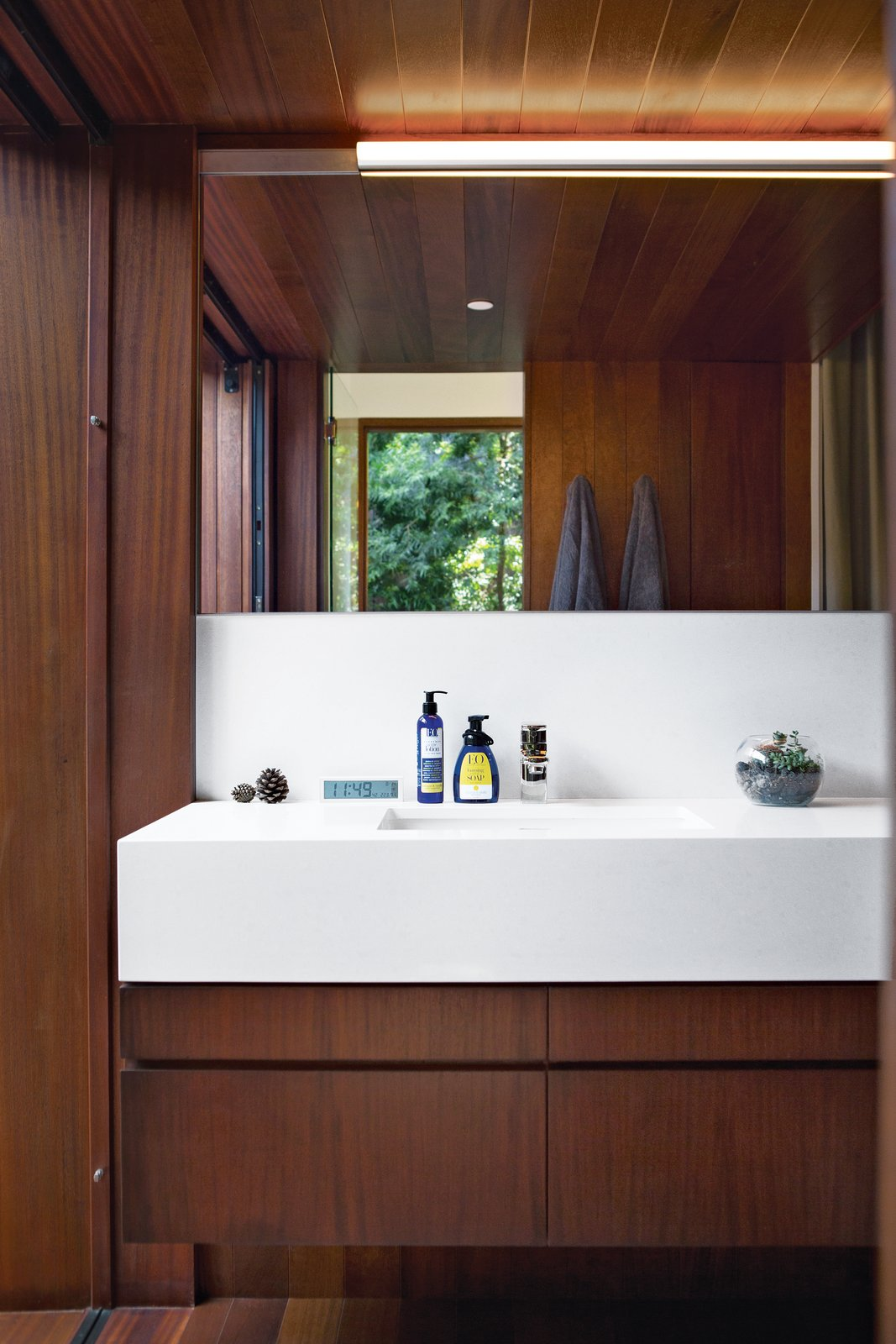 The couple chose to contrast the wood in the master bath with a smooth Caesarstone counter in Organic   White 4600, which was measured and cut specifically for the space. They added a bit of shine with polished-nickel Upton fixtures from Toto. Photo by Coral von Zumwalt.  Bathroom by anne nguyen from A Modern Bungalow in Venice Beach