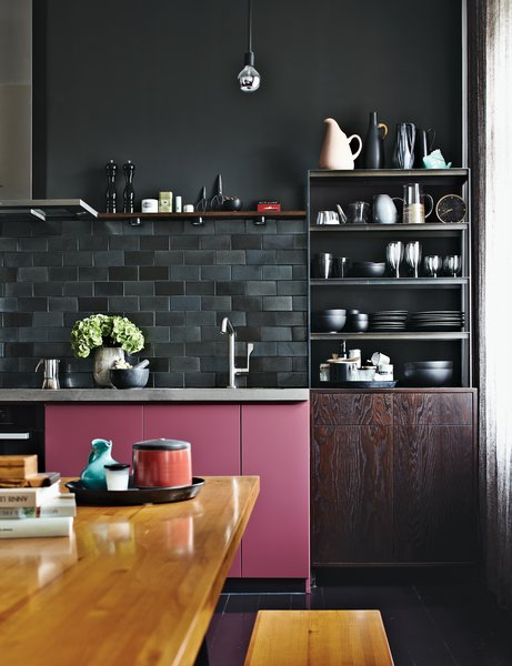 He created the star as a prop for a photo shoot. The kitchen cabinets benefit from a pop of rosy color, a custom hue. Fehrentz designed the steel-and-wood storage unit.