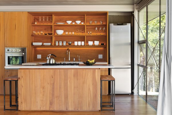 By balancing the light from a variety of sources and ensuring that every corner was illuminated, Terry Ohm increased the feeling of expansiveness in the 12-and-a-half-by-14-foot kitchen. Photo  of Mayacamas Residence modern home