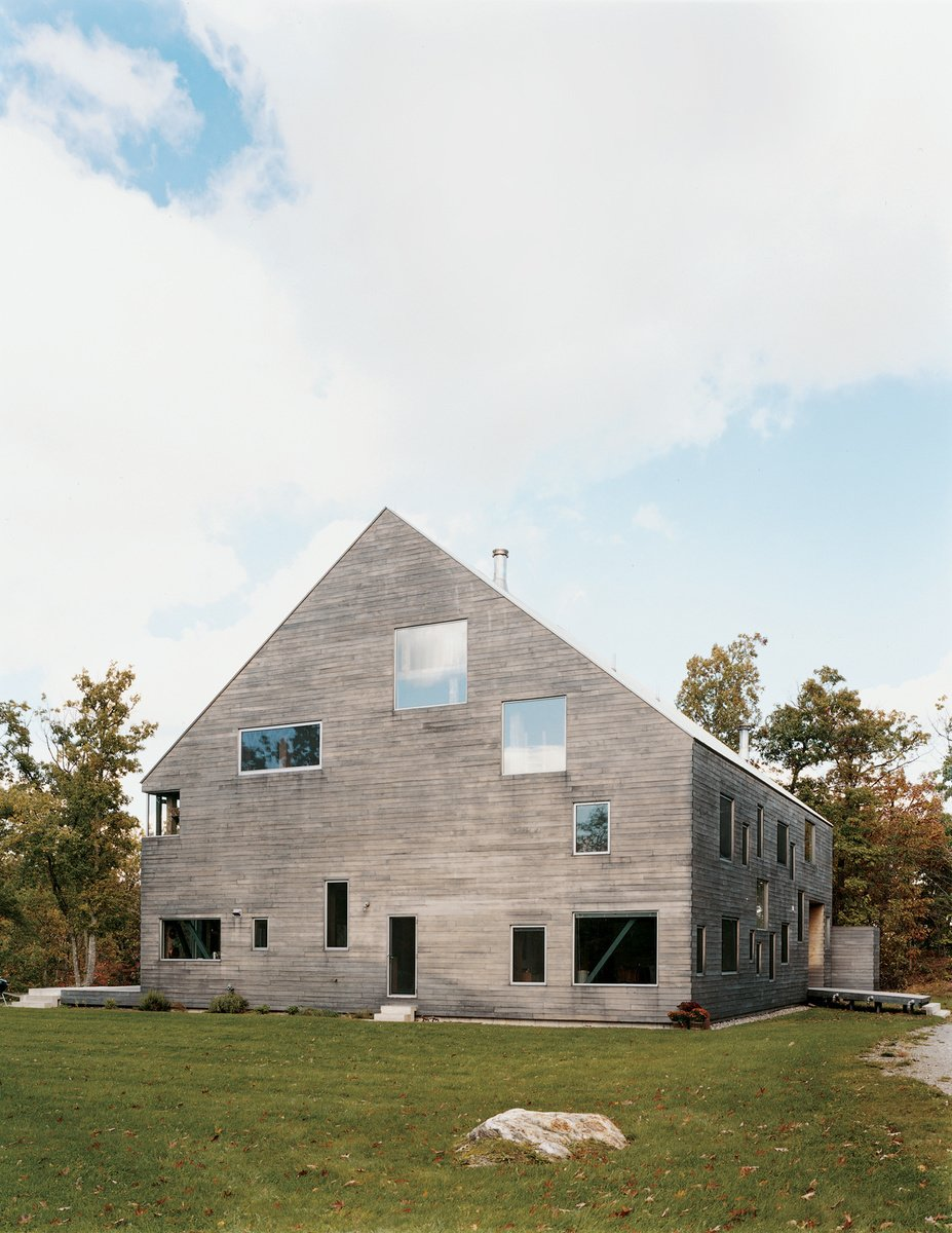 "The Pine Plains, New York, home of Elise and Arnold Goodman boasts 48 windows, the largest of which measures 8'6'' by 7'6''. As architect Preston Scott Cohen explains, the ""free facade makes it impossible to identify how many levels there are, or even to tell the difference between a door and a window."" Photo by: Raimund Koch  Modern A-Frame Homes by Erika Heet"