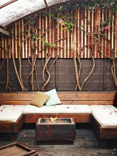 The Tiny Hollywood Home of Mad Men's Vincent Kartheiser - Photo 11 of 13 - Kartheiser's private courtyard includes a covered seating area and fire pit, designed by Roberts.