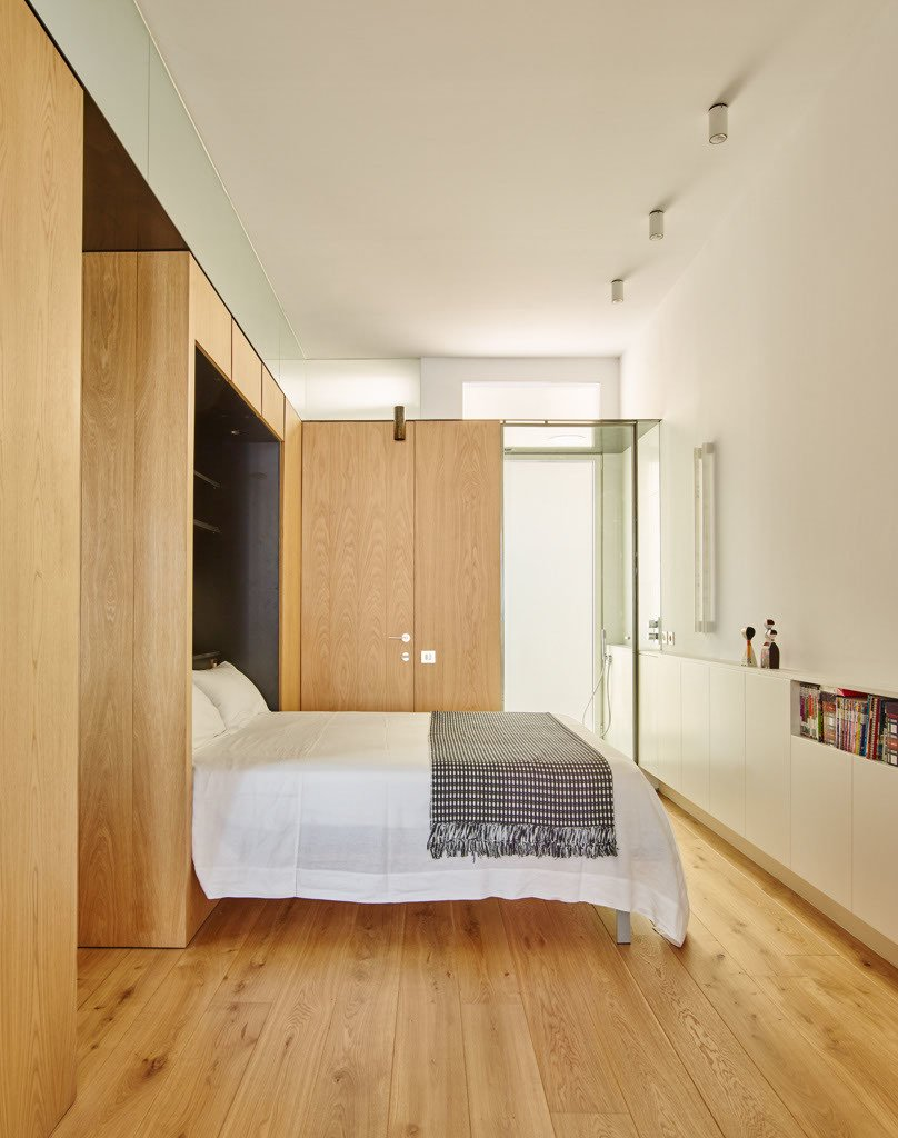 In the guest room, for example, the built-in unit contains a pull-down Murphy Bed, which makes the most of the elongated space.  Bedrooms by Dwell from A Multifunctional Built-In Updates this Mosaic-Filled, 19th-Century Spanish Flat