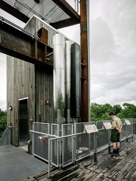 At the structure's top, a 4,000-watt wind turbine and 6,500-watt photovoltaic array offers lessons about renewable energy. Photo 5 of Sustainability Treehouse modern home