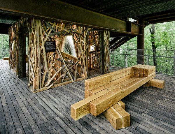 A bench offers a place to rest and take in the surrounding tree canopy. Creating opportunities for contemplation is another key element of the structure's design. Photo 7 of Sustainability Treehouse modern home