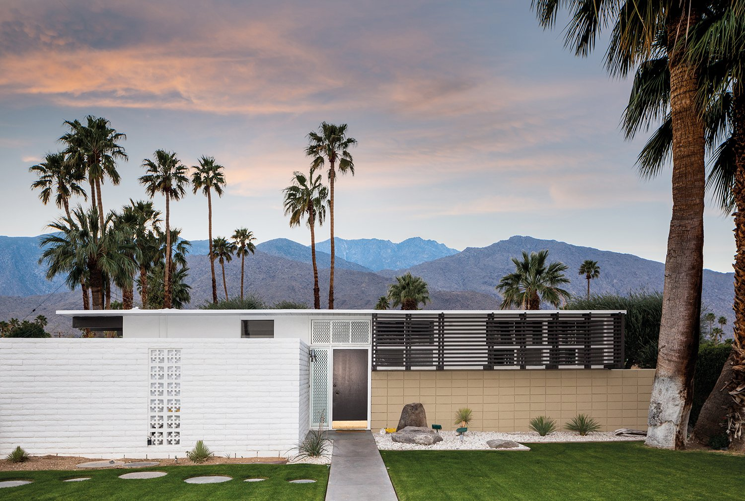 Another 1956 tract house with a flat roof designed by Krisel. Tagged: Exterior, House, Mid-Century Building Type, Flat RoofLine, Brick Siding Material, and Concrete Siding Material.  A Crash Course in Palm Springs Architecture by Matthew Keeshin from Midcentury Lovers: You Can Thank This Architect for Transforming Palm Springs Into a Modernist Hotbed