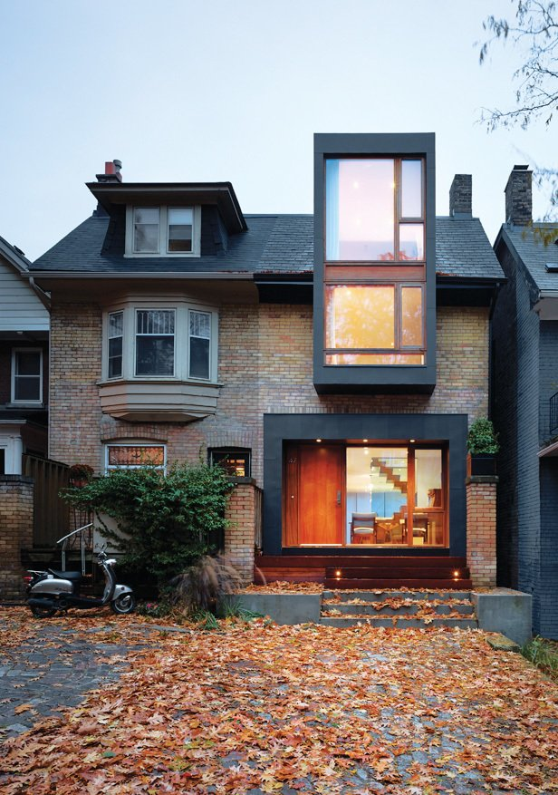Mandel mounted the fireplace in a blackened-steel frame, which echoes the window and door treatment on the house's new facade.
