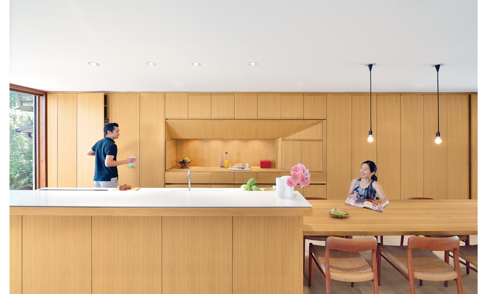 The white oak used for the cabinets, kitchen island, and dining table is finished with double-boiled linseed oil, which can be reapplied by the homeowners as the wood mellows and patinas.