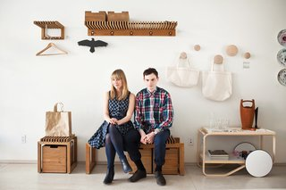 Design Shop Visit: Mjölk in Toronto - Photo 1 of 9 - Daoust and Baker sit among a Siwa tote bag by Naoto Fukasawa, Cutter benches and shelves by Niels Hvass, and Dots wall hooks by Tveit & Tornøe for Muuto.
