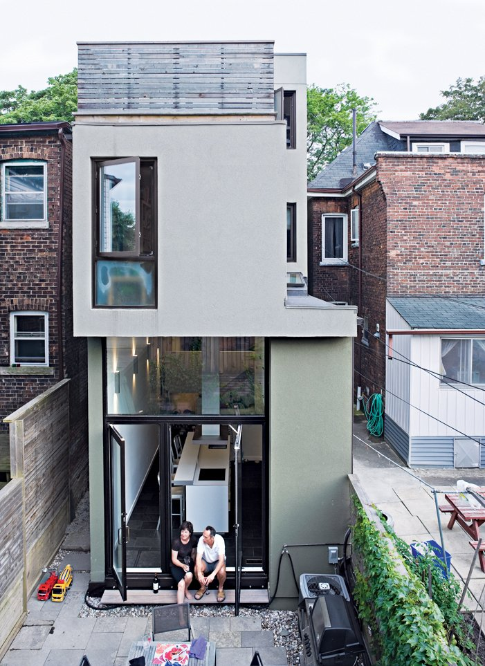 A rear view of the narrow house shows how Chong twisted the house's volumes to bring daylight into each room. Narrow Modernist Three-Story Home in Toronto - Photo 16 of 18