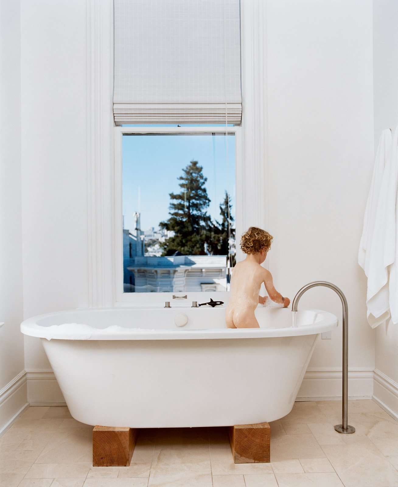 Jonathan Nelson's one wish for the master bathroom was for views from the Zuma tub. He got that and then some, and now three-year-old Jonas (pictured) and his older brother refuse to bathe anywhere else. The stand-alone faucet is by Lefroy Brooks from the XO collection.  Photo 3 of 8 in Taking Liberties