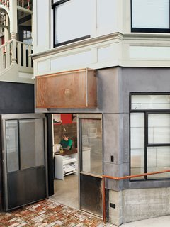 Modern Victorian House Preservation in Oakland - Photo 2 of 6 - Ian Read wanted the addition to reflect the time in which it was constructed, not the Victorian times in which the house was erected. The industrially styled doors situate the office space squarely in the 21st century.