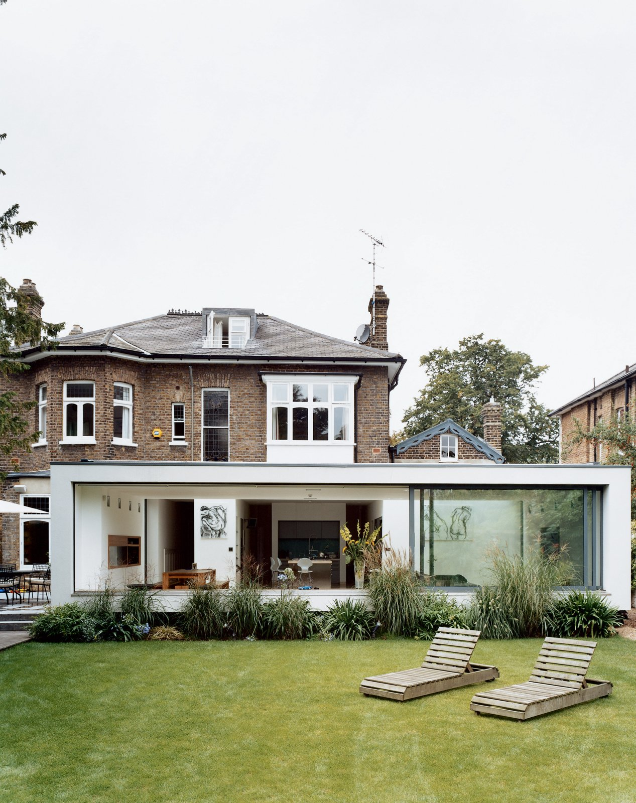 """New residential buildings are few and far between in England, so architects like Phillips have increasingly been charged with creating groundbreaking modern environments within the shells of historic houses. """"People just find it easier to work within existing houses to transform them to be sleek, stylish and functional,"""" says Phillips. """"Extensions have almost become a requirement for any homeowner who wants to be a part of modern living within the U.K."""" Victorian Secrets - Photo 10 of 10"""