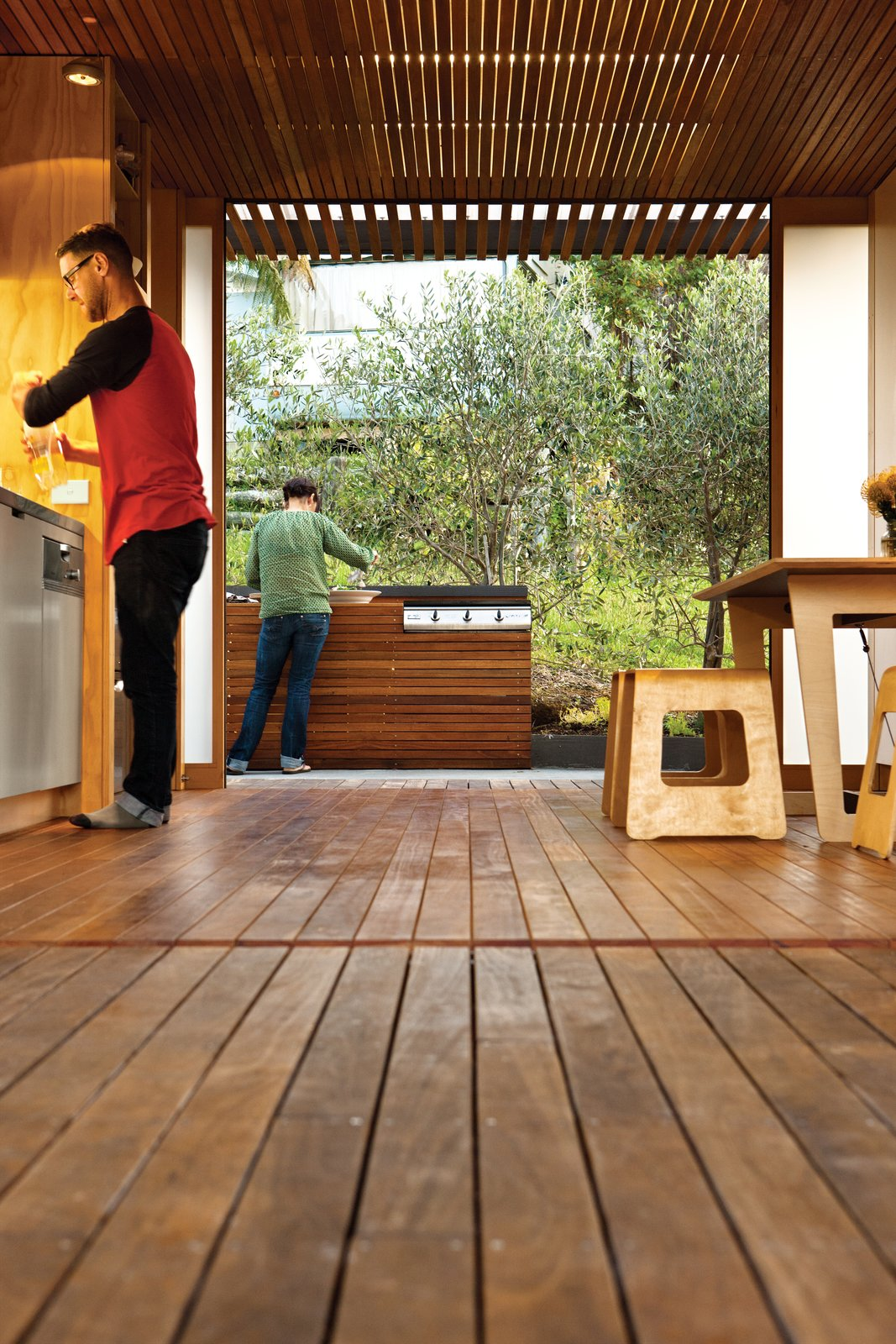 Eucalyptus is used for the kitchen floor and ceiling slats. A Compact Prefab Vacation Home - Photo 6 of 7