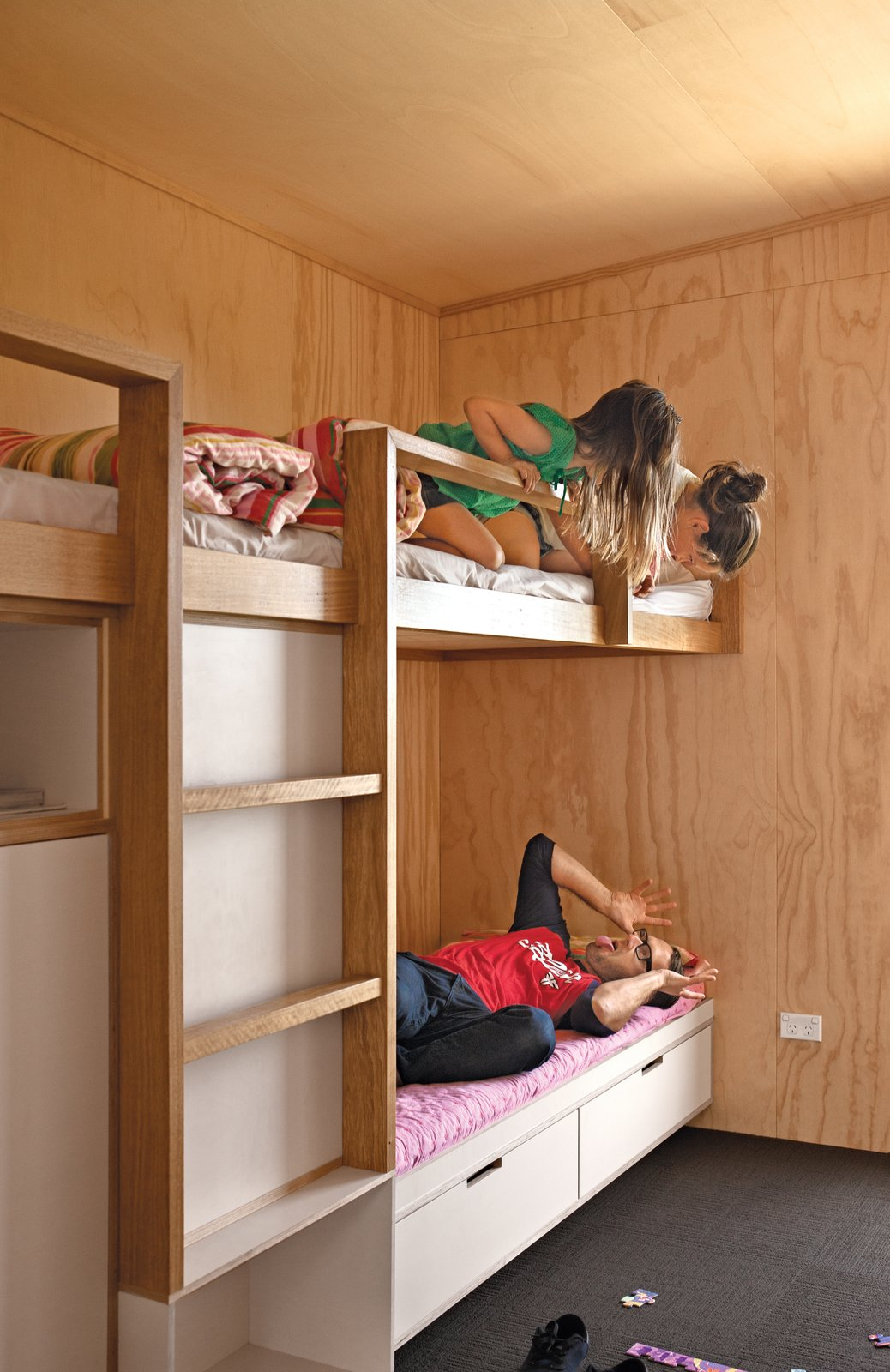 Architect Dave Strachan and the Unitec students designed and built the living room sofa and bunk beds. The carpet squares are by Interface.  Photo 7 of 7 in A Compact Prefab Vacation Home