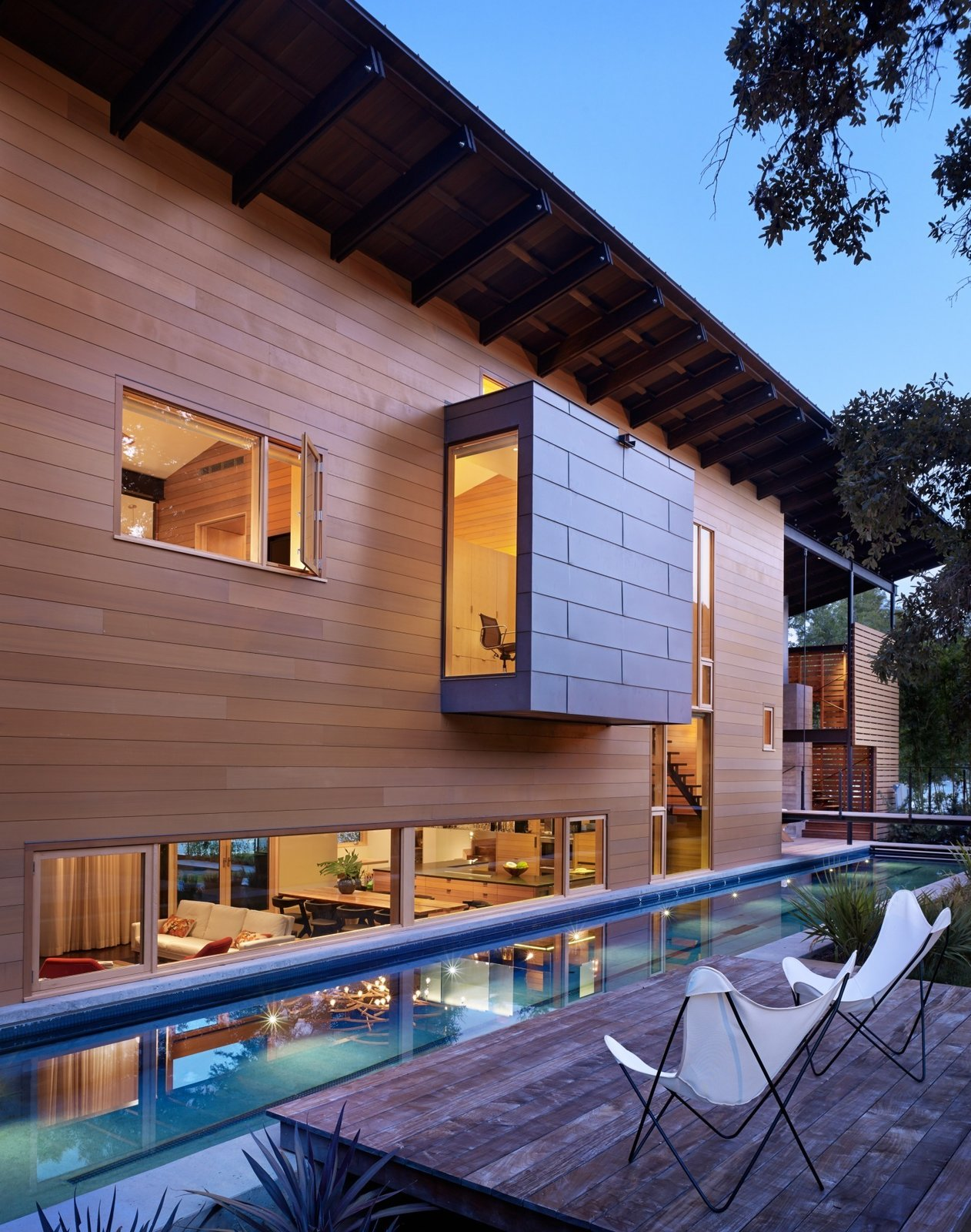 """Exposing the craft and detail of the materials was a key part of the design,"" Flato notes. The texture of the house, he says, can be observed in the concrete retaining wall for the lap pool. Tagged: Large Pools, Tubs, Shower, Wood Patio, Porch, Deck, Small Patio, Porch, Deck, Back Yard, Exterior, House, and Wood Siding Material.  Modern Pool Design by Dwell from Hog Pen Creek"