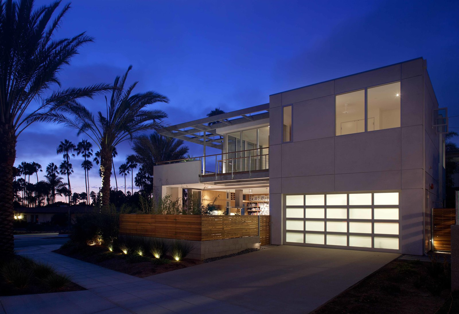 Much of the home's design is based around a large, structural steel trellis supported by the second floor balcony. The top of the trellis is formed by frameless solar panels that provide the family with the majority of their daily energy needs.  Photo 4 of 7 in Green Home in La Jolla Blends Indoors and Outdoors