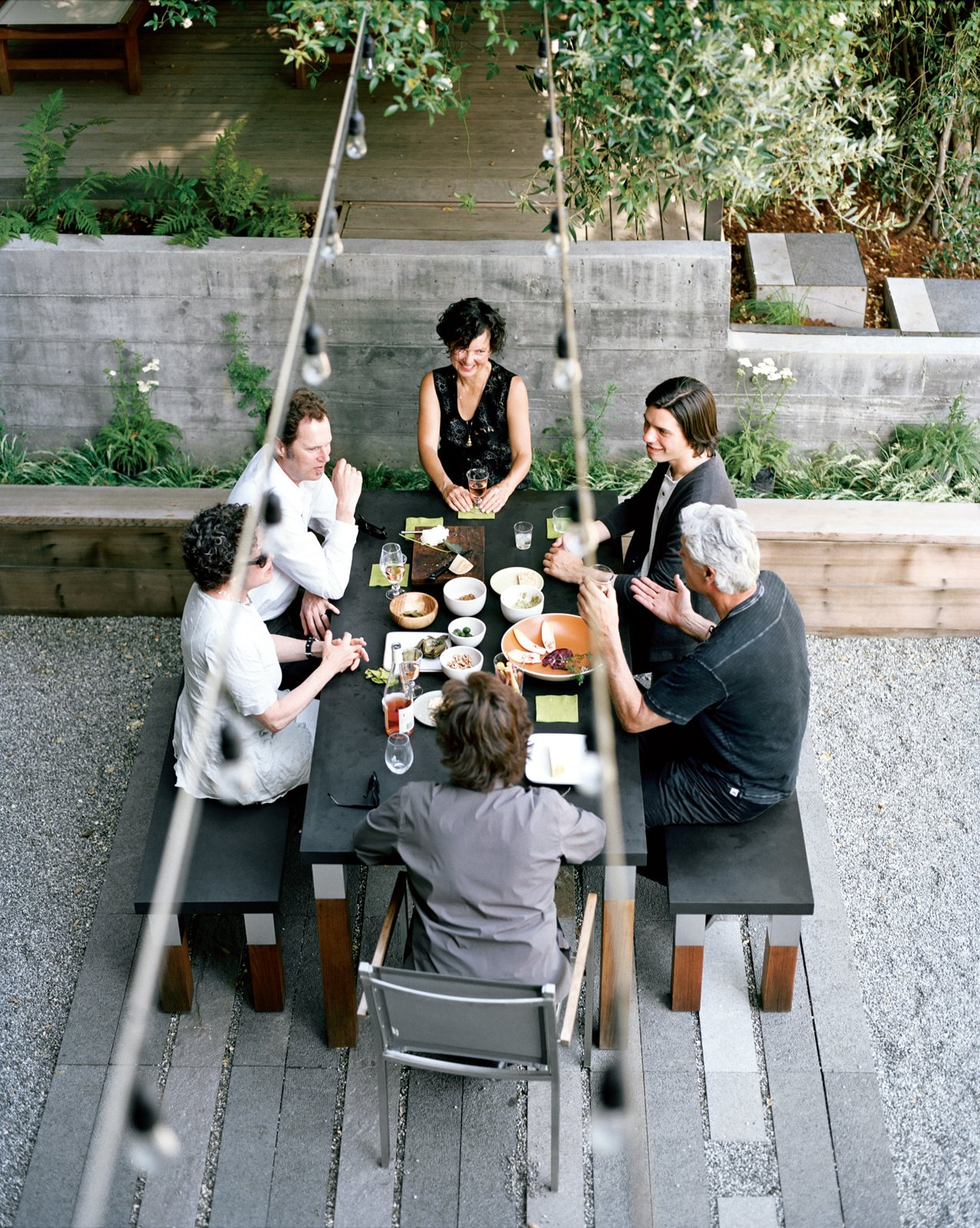A Bay Area landscape designer works her yard like a jigsaw puzzle, packing a bevy of distinctive destinations into a steep and diminutive plot.  Photo by: Morgan Rachel Levy  Read the entire article here. Tagged: Outdoor and Back Yard.  Photo 3 of 4 in Charming Weekend Cottage Renovation in Marin