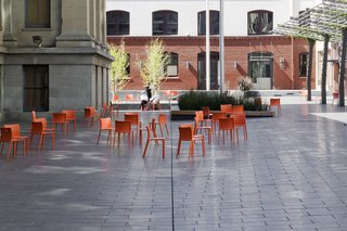 CMG Landscape Architecture - Photo 3 of 13 - Mint Plaza in San Francisco used to be a highly sketchy back alley. Today it's a vibrant public pedestrian plaza and festival space lined with restaurants and cafes, filled with dozens of movable bright orange chairs and shaded by a vine-covered steel trellis.