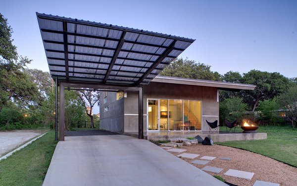 Wong consulted with an old neighbor, Austin-based landscape architect Eleanor McKinney, on landscaping, and she steered him toward a maintenance-free hardscape, which Wong designed himself with crushed granite, square pavers and limestone and basalt boulders from Austin Stone Supply. The lawn was already in place and never needs water, notes Wong. Just beyond the glass entrance door is the living/studio area; the interior stair leads to the sleeping loft.